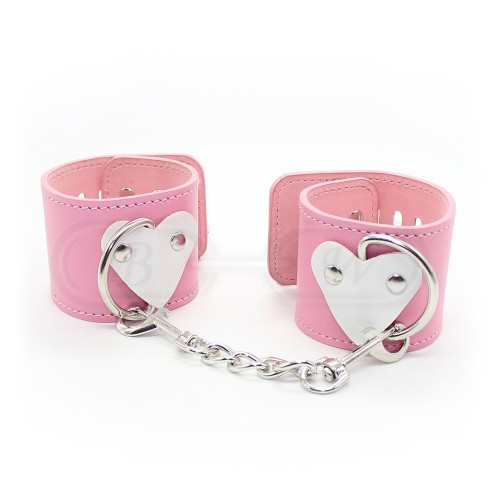 Pink Faux Leather Wrist Cuffs with Heart Decoration